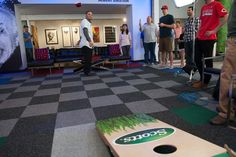 Hector Santiago #53 of the Chicago White Sox tosses a trick shot in corn hole to raise money for Scotts Sandy Relief during a visit to the MLB Fan Cave Wednesday, September 4, 2013, at Broadway and 4th Street in New York City. (Photo by Thomas Levinson/MLB Photos via Getty Images)