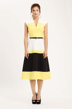Eden Row Siena dress is made from crepe with a wide black stripe of snake jacquard. Slight cap sleeve with v-neck and flared a-line skirt. The belt can be worn two ways - one side is black coloured, but twist the buckle and you get a gorgeous gold colour. Dress for the races or wedding guest
