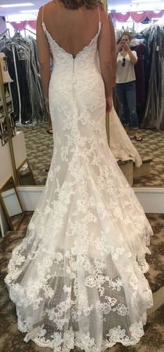 8230f70887 Beaded lace appliques on point d esprit over luxe satin gown. Beaded lace  applique