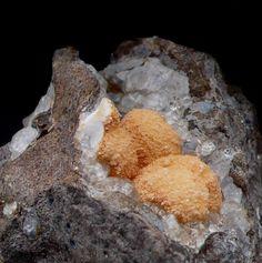 "Gonnardite, (Na,Ca)2(Si,Al)5O10·3H2O, Analcime, ""Cornorotto"" locality, Chiavon Nero creek, Fara Vicentino, Vicenza Province, Veneto, Italy. Fov 18.3 mm. Gonnardite balls up to 6 mm. on analcime in a cavity of basalt. Copyright © Alessandro Tagliaferri"