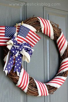 Old Glory Patriotic Wreath: Before Independence Day arrives, we suggest taking a trip to your local dollar store to put together this inexpensive decoration. Click through to find more quick, DIY of July wreaths to add to your summer home decor. Flag Wreath, Patriotic Wreath, Diy Wreath, Wreath Ideas, Patriotic Crafts, Patriotic Party, Wreath Making, Grapevine Wreath, Memorial Day Wreaths