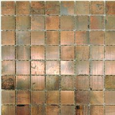 copper tile for an accent strip in the backsplash
