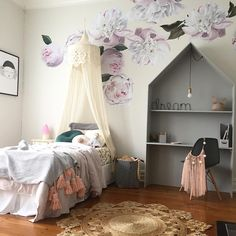 Girl's room with bed canopy, rose walls, house desk. Instagram photo by @salted_grace
