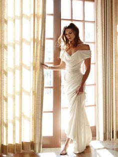Vivienne Westwood Gold Label dress, $4,100, 323-951-0021. Tiffany & Co. ring, $9,800, and bracelet, $9,800, 310-273-8880. Harry Winston cluster bracelet, price upon request, 310-271-8554.