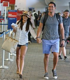 Happy couple: Andi and Josh held hands while flying out of Laguardia airport in New York o...