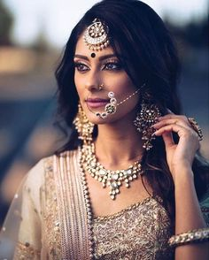 Kundan and antique gold nose ring set with matching maang tikka, necklace and earrings | bride in crème and gold suit | Indian Wedding Ideas | Nose Rings | Indian Accessories | Bridal Look | Credits: ShaadiSaga | Every Indian bride's Fav. Wedding E-magazine to read. Here for any marriage advice you need | www.wittyvows.com shares things no one tells brides, covers real weddings, ideas, inspirations, design trends and the right vendors, candid photographers etc.