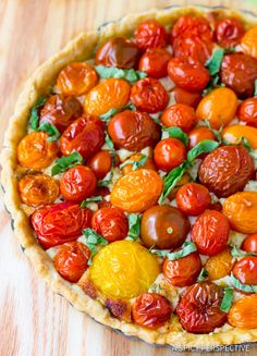 Vibrant Fresh Tomato Tart with a creamy cheesy base and buttery crust. This spin on the classic southern tomato pie is a winner in taste and visual appeal!