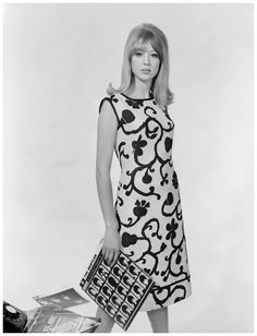 "serafino-finasero: ""English model Pattie Boyd in a dress by Brilkie, in her hand the 1964 album A Hard Day's Night by The Beatles 