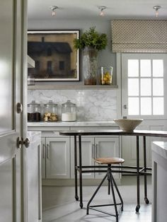 Textured roman shade gives a vintage look to this classic kitchen window www.budgetblinds.com/sanramon