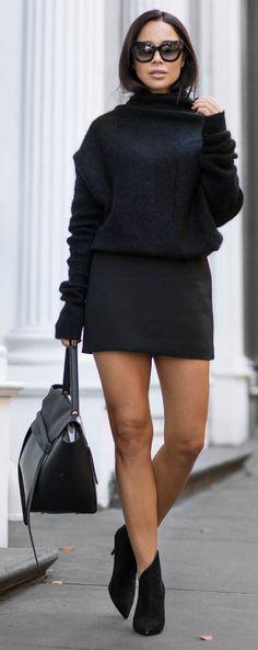 Johanna Olsson's cropped black extra long sleeved sweater looks cute worn with a black mini skirt and heels. Shoes: Giuseppe Zanotti, Sweater: Acne, Skirt: Zara, Sunglasses: The Valley, Bag: Celine.