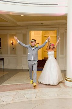 "When your DJ or band announces your names and guests rise to their feet, set the tone with a fun anthem, like this couple did (they chose ""Party Rock Anthem"" by LMFAO). Show off your best dance moves (and sense of humor) with hilarious props. Find tons of song recommendations for your wedding here.Photo Credit: Disney Fine Art Photography and Video"