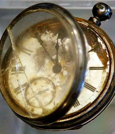 This photo shows a pocket watch found in the belongings of a third class passenger named William Henry Allen, found in the Titanic wreckage, among a sampling of Titanic artifacts on preview for auction in New York.  (AP / Bebeto Matthews)