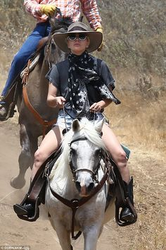 Lady Gaga wears large hat and cowboy boots and puffs on a cigarette as she rides her horse in Malibu   Daily Mail Online