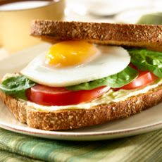 Breakfast Sandwich, Egg, Tomato & Spinach   Calories 250 Calories from Fat 90 Total Fat 10g 15% Saturated Fat 2.5g 13% Trans Fat 0g Cholesterol 210mg 70% Sodium 390mg 16% Potassium 0% Total Carbohydrate 26g 9% Dietary Fiber 5g 20% Sugars 4g Protein 14g