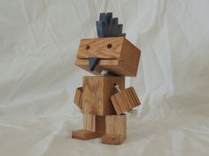 This awesome robot is sporting a blue Mohawk with a matching soul patch. Hes made from 100% reclaimed Ash hardwood and stands just over 6