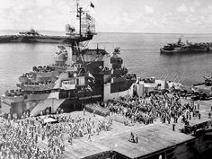 Ceremony on Hornet CV-12 by Admiral Mischer to honour the crew and air-group for their part in the conquest of the Marianas. USS Essex on the starboard with the other being th light carrier San Jacinto CVL-30.