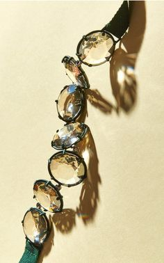 The latest name to collaborate with the famed crystal house, Atelier Swarovski, is designer-of-the-moment Rosie Assoulin. Focused on a palette of denim, moss and light topaz, the New Yorker works her off-beat take on femininity into modern iterations of the sparkling stone.