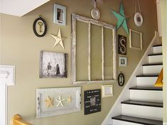 Repurposed items wall; you could add wire and clothes pins to frame to hang photos