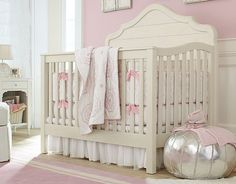 Pale pink and white girls nursery with silver pouf