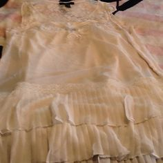 Like new ivory lace tunic w/ attached tank top Like new ivory lace tunic with built in tank top.  Sleeves of tunic are 3/4 Length. Bottom of tunic has double layer of lace and pleats.  I don't trade. Forever 21 Tops Tunics