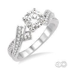 Gorgeous Round Center Diamond Engagement Ring set in 14k White Gold with Dazzling Criss-Cross Design.