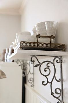 beautiful shelf detail for the bathroom except with wooden shelf with blue or yellow distressed brackets