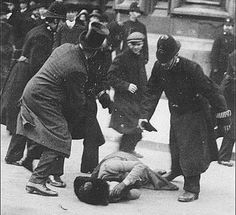 NOT SUSAN B ANTHONY -- See the clothes? It's London, 1910, outside Parliament, where police beat protesters. SEE COMMENTS -- The Daily Mail said this woman is Ada Wright. and s lesson plan from UK National Archives says Ernestine Mills. [Clearly NOT Mrs. Pankhurst] There weren't just a few famous suffragists - there were thousands. [Link goes to Edith Garrud, first female martial artist in the Western world, who trained in ju jitsu & led a 30-woman bodyguard to protect protestors from police.]