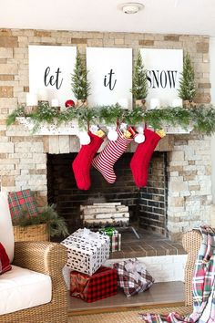 christmas-mantel-decorating-with-greenery and lettering on large canvases