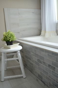 Love the wood-look tile on the floor and shower wall. AND, using the same tile as a baseboard. AND, transforming dressers into vanities. Overall a beautiful makeover. Old Bathrooms, Dream Bathrooms, Bathrooms Decor, Farmhouse Bathrooms, Bathroom Renos, Master Bathroom, Bathroom Ideas, Bath Ideas, Small Bathroom