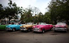 HAVANA, CUBA - SEPTEMBER 16: Vintage American cars being used as tourist taxis are parked alongside ... - Getty Images