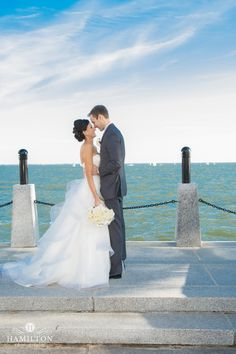 United States Naval Academy & Westin Wedding Blog — Wedding Savvy Inc. Groom and Groomsmen on the water in Annapolis.