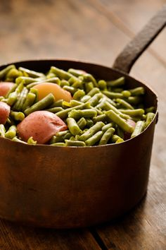 Paula Deen Green Beans with New Potatoes. One of my favorite side dishes, ever. I leave out the bacon grease, and cut down the butter by alot, and it's still delish! Use good chicken broth because it adds a ton of flavor!