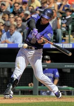 Colorado Rockies' Carlos Gonzalez (5) hits a 2-run home run to take a 1 run lead over the Los Angeles Dodgers during the 5th inning of the MLB National League baseball game Saturday June 1, 2013 in Denver. (AP Photo/Barry Gutierrez)