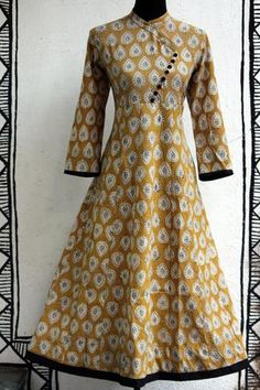 a long traditional anarkali with cross button potlis in angrakha style, inspired by mughal folklore. the leaf yellow anarkali with handblock print of leaves a Kurti Sleeves Design, Kurta Neck Design, Kurta Patterns, Dress Patterns, Dress Neck Designs, Blouse Designs, Neckline Designs, Indian Attire, Indian Outfits