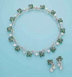 TSAVORITE GARNET AND DIAMOND 'IVY' SET The necklace designed as interlinking sprigs of pavé-set tsavorite garnet ivy with pavé-set diamond branches and rose-cut diamond berries, detachable ear pendants en suite, mounted in platinum