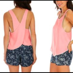 Criss Cross Top Round out a fashionable wardrobe with this chic cross-back tank. A soft fabric blend provide style and comfort to boot.  Runs true to size Tops