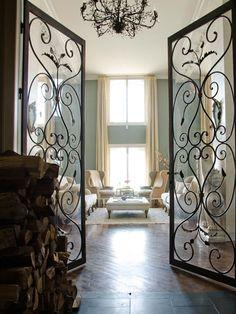 living room, metal doors, firewood, wood floors, paris, robins egg blue walls