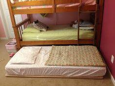 Simple, smart DIY trundle bed. With sliders instead of wheels.