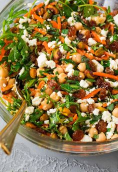 Moroccan Chickpea Salad with Carrots, Quinoa, and Feta. A bright, filling, healthy salad filled with Moroccan spices and fresh ingredients. Get the recipe here! Moroccan Chickpea Salad, Moroccan Salad, Mediterranean Chickpea Salad, Mediterranean Recipes, Greek Chickpea Salad, Winter Salad Recipes, Chickpea Salad Recipes, Healthy Salad Recipes, Vegetarian Recipes