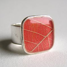 """leaf ring. This is an original one of a kind art piece (as in, no two leaves are exactly the same) that you can wear on your finger. This ring's focal point appears to be the veins from a leaf, but it's actually a leaf skeleton over a piece of cardstock."""""""