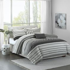 The Madison Park Pure Neruda Collection creates an organic look for your modern space. This interesting seersucker stripe adds dimension and simplicity with textured grey and off white stripes. Printed on 200 thread count cotton, this set includes a duvet cover, two shams and two decorative pillows.