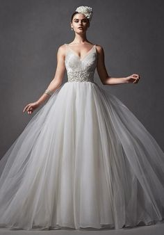 Tulle creates this romantic ballgown, complete with lavish beaded, plunging illusion neckline and soft, voluminous skirt | Sottero and Midgley | https://www.theknot.com/fashion/forsythia-sottero-and-midgley-wedding-dress
