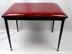Handy little table/stool/ottoman upholstered in sensational leopard spotted Italian leather.