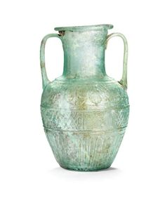 A Roman two-handled blue-green glass amphora signed by Ennion, circa first half of the 1st century A.D.