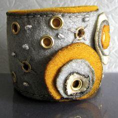 Felt Bracelets by OpusMuse. The grommets are a great idea