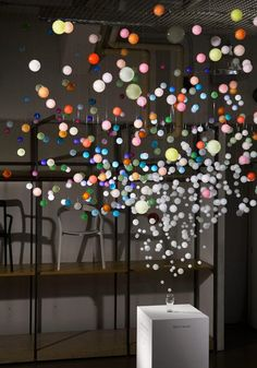 """""""Sparkling Bubbles"""" is an incredible installation uses 800 acrylic transparent spheres bringing the experience of the bubbles and sparkles of Coca-cola, created by artist Emmanuelle Moureaux"""