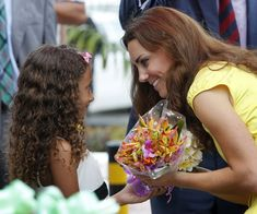 She chatted with a young girl who gave her flowers in the Solomon Islands in September 2012.