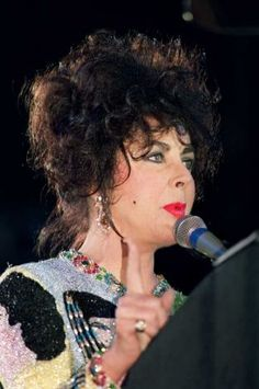 American actress Elizabeth Taylor speaks to the large crowd at Wembley Stadium on April 20, 1992 as she attends the Freddie Mercury tribute concert in aid of AIDS research. AFP PHOTO THIERRY SALIOU Photo: THIERRY SALIOU, AFP/Getty Images / 2009 AFP