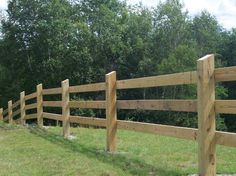 This 3 rail board fencing in Stowe Vermont is built entirely from pressure-treated lumber.