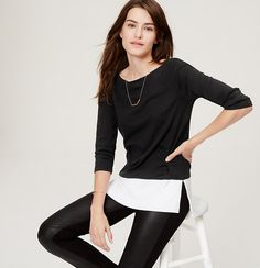 A two-hue scheme plays out beautifully in this sleek boatneck style. Boatneck. 3/4 sleeves. Banded neckline. Side slits.
